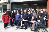 Cutting the Ribbon in front of Inclusion Center
